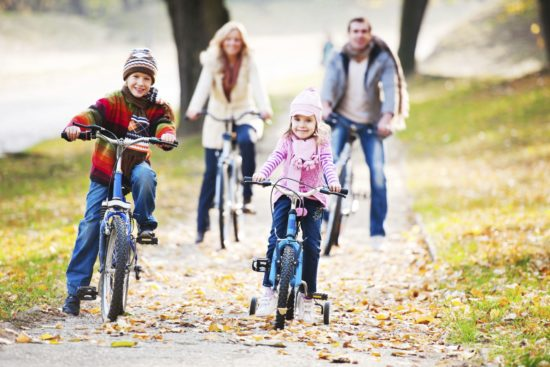 Beautiful family riding bicycles in a park during autumn season. The focus on foreground.   [url=http://www.istockphoto.com/search/lightbox/9786778][img]http://dl.dropbox.com/u/40117171/family.jpg[/img][/url] [url=http://www.istockphoto.com/search/lightbox/9786682][img]http://dl.dropbox.com/u/40117171/children5.jpg[/img][/url]
